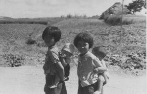 Girls with babies Jul1945 Okinawa