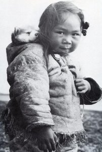 Inuit Child with husky